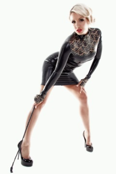 Mistress Dannii Harwood is dressed in a very sexy black latex catsuit with a whip