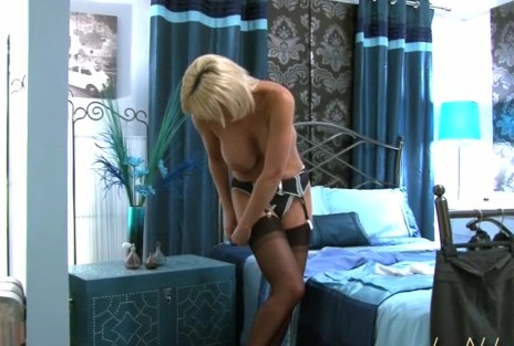 Jans Nylon Sex videos: Busty blonde british MILF Jan getting ready for work