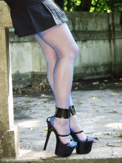 Nicole posing in blue nylon stockings