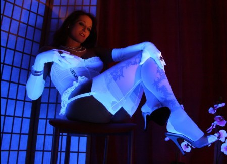 Nadjas Nylons pictures: Sexy redhead Nadja in white lingerie, nylon stockings in blacklight
