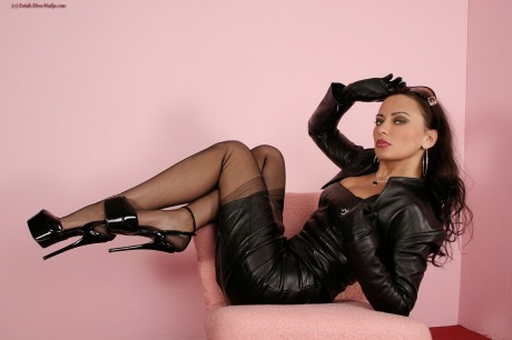 Fetish Diva Nadja in leather, black seamed nylons and ultra high heels