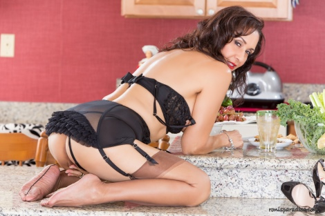 Roni in girdle and stockings in the kitchen