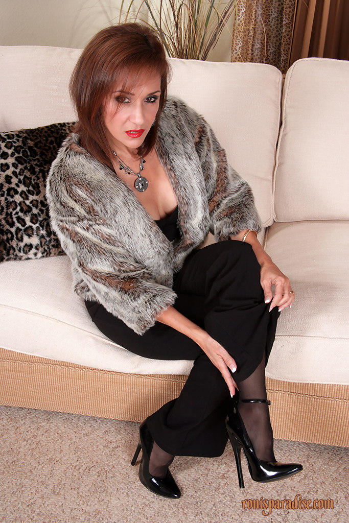 Mature in fur coat and stockings