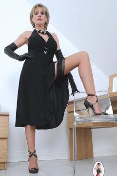 Lady Sonia in long black dress and seamed nylon stockings