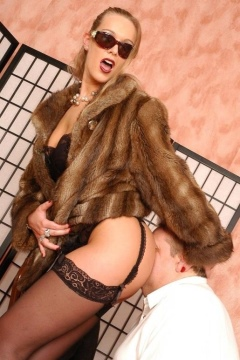 Lady Joanne in fur coat and stockings facesitting