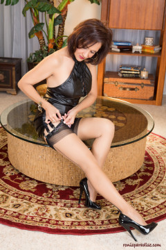 Roni from Ronis paradise in leather dress and stiletto heels nylon stockings with garters