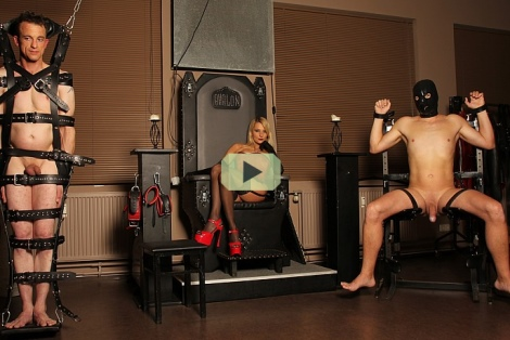 mistress natalie black video, natalie in corste stockings and heels in dungeon with two slaves