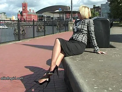 Stiletto girl Sonia blonde mature in pantyhose and heels walking outdoors