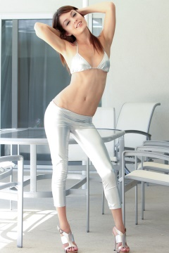 young girl in tight silver pants and shiny bra get naked