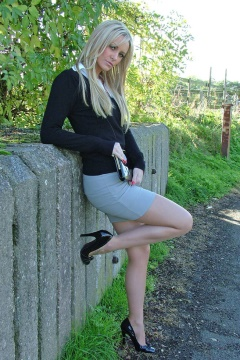 Stiletto Girl blonde sexy Erin in pantyhose and heels outdoors