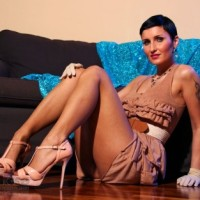 aPantyhose free video: Shorthaired brunette in nude tights