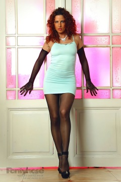Hot redhead teases in black pantyhose, short white dress and gloves