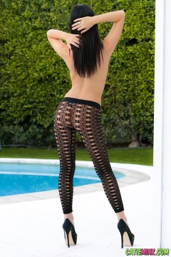 Darkhaired babe Catie Minx in fishnet tights and high heels