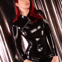 Redhead in latex dress and stockings – Emily Marilyn