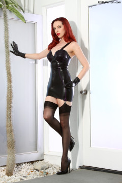 Redhead in latex mini skirt and black nylon stockings Emily Marilyn