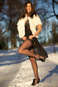 Fetish mistress in fur coat and nylon stockings in the snow Miss Hybrid