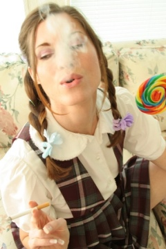Pigtailed sexy Candie flirts with a cigarette and lollipop Alta Smoking