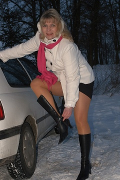 Car pantyhose feet and legs tease Angle Lovette boots outdoors