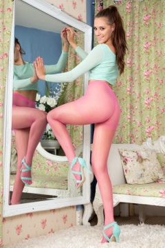 Cute british babe Becky Perry shows her long legs in pink pantyhose