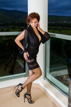 Roni Ford sexy black pantyhosed legs, high heels, black dress Ronis Paradise