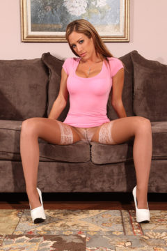 Capri Cavanni in pink dress and pantyhose worn over white stockings and heels
