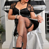 Amanda Nylons feet and legs in white and black seamed stockings