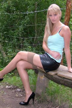 Blonde Stiletto girl Alexis outside in stockings and black shiny stilettos heels
