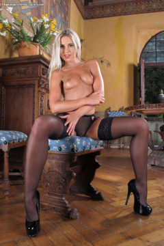 Blonde Lola in stockings and lingerie masturbates her pussy