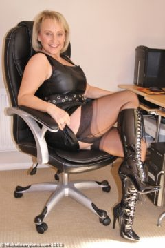 Blonde mature Michelle in leather dress, nylons and boots Michelle Nylons gallery