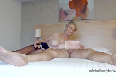 Michelles Nylons free video Michelle strokes a hard cock on a bed