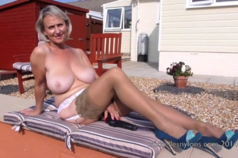 Blonde milf in stockings sunbathing and more!
