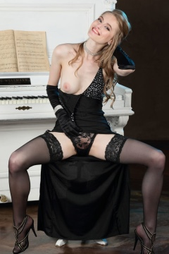 Rebecca G MetArt pics Elegant blonde in black dress and stockings