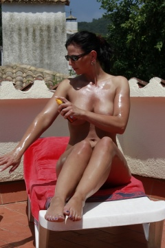 Desyra Noir nude pics Desyra hot oiled body big tits milf sunbathing
