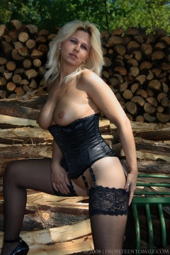 Young Desyra Noir nude outdoors in corset black stockings with garters