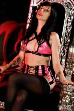 Young mistress Lynn Pops posing in pink latex lingerie black stockings